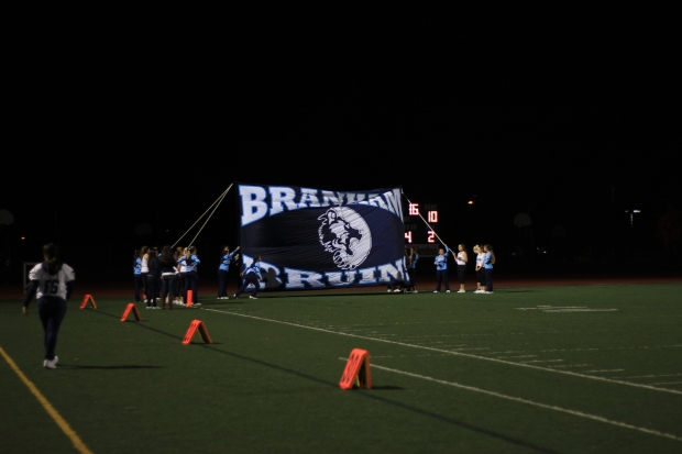 Branham's Cheer team held up the Burin banner for each of the football team's entrances setting the tone for the game.